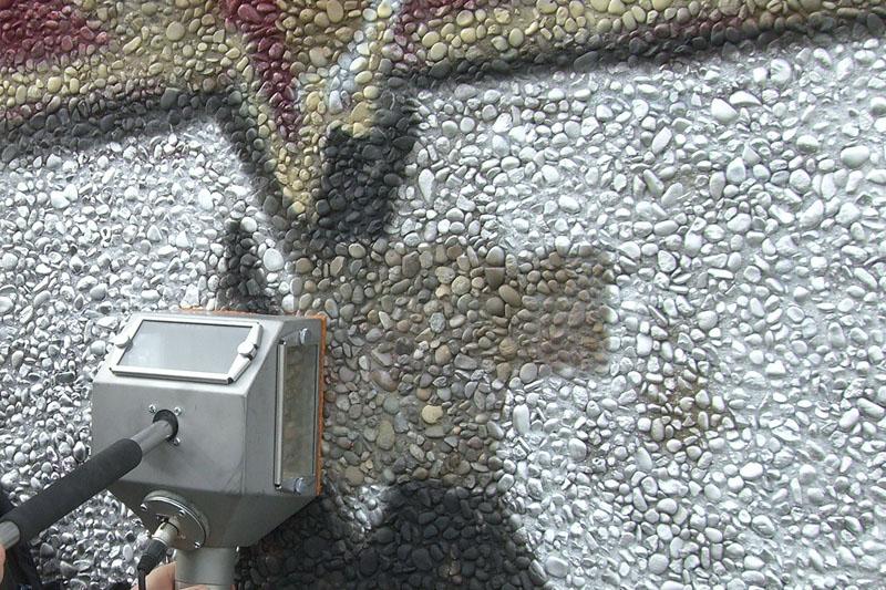 Graffiti removal from pebble wall